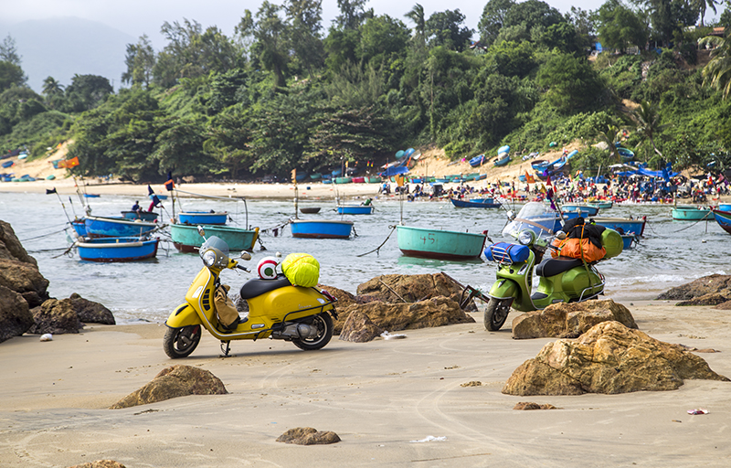 Binh Dinh, Viet Nam - Nov 10, 2017: Vespa GTS motorbike is on the beach road in the roadtrip and test drive in Vietnam.